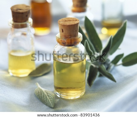 Small bottles of sage oil - stock photo