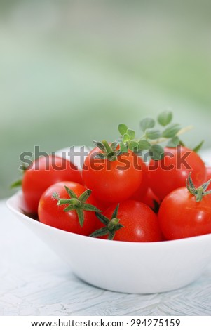 small bowl of cherry tomatoes on the table