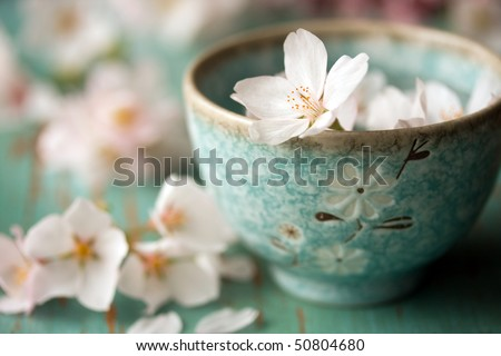 small bowl with flowers - stock photo