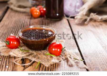 Small Bowl with homemade Barbeque Sauce on wood - stock photo