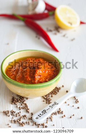 Small bowls of homemade harissa with red chili - stock photo