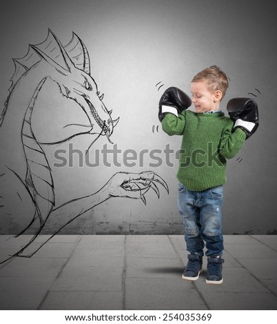 Small boxer plays to defeat a dragon - stock photo