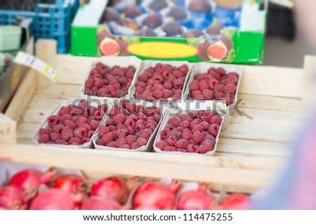 Small boxes with raspberry on street market