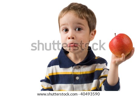 Small boy and apple isolated on white