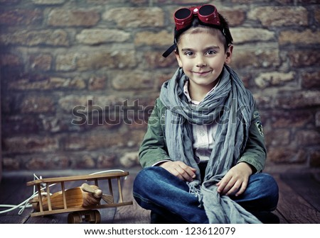Small boy as a pilot - stock photo