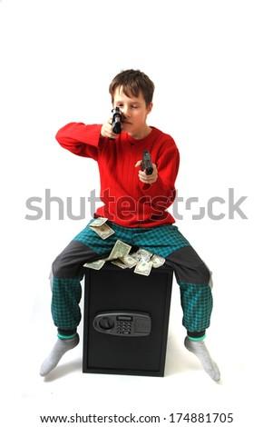 small boy guns and safe - stock photo