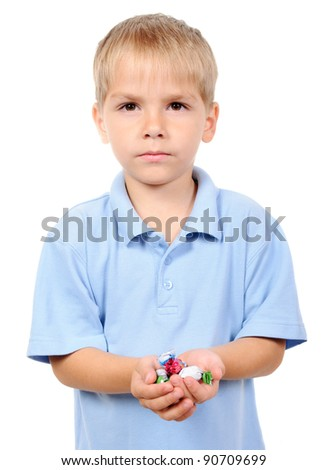 Small boy hold candies in hand isolated on white background - stock photo
