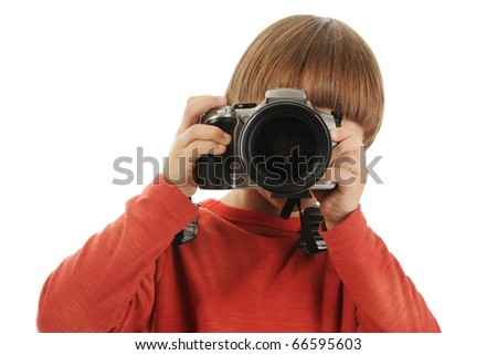 small boy holds a big camera in his hands. Isolated on white background - stock photo