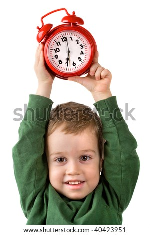 small boy holds alarm clock