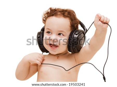Small boy in big black headphones on white background
