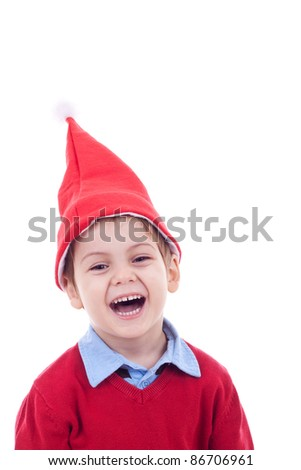 small boy in Christmas bonnet looks at camera, on white background - stock photo