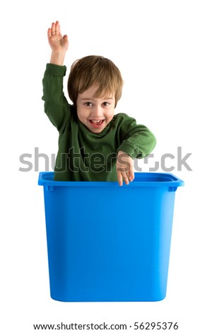 Small boy in the toy box isolated on white
