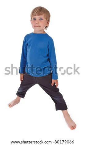 small boy is trying to make twine on white background - stock photo