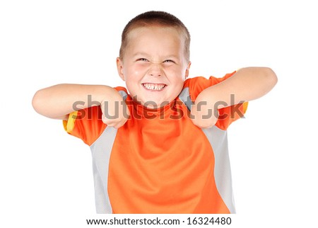 Small boy misbehaving and loving it - stock photo