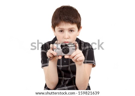 small boy photographing horizontal with digital camera on white background - stock photo
