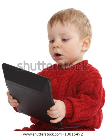 small boy play with calculator - stock photo