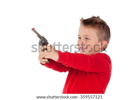 Small boy playing with a gun isolated on white background - stock photo