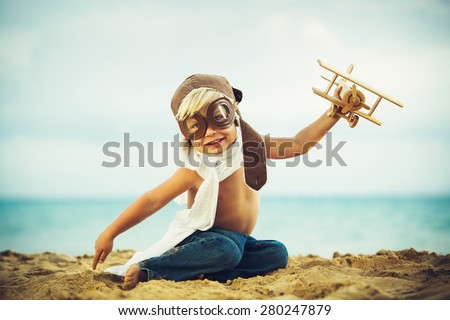 Small Boy Playing with Toy Airplane - stock photo