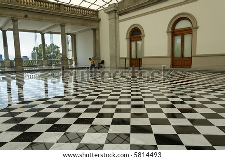 Small boy plays in main salon in Chapultepec Castle, Mexico City