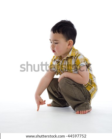 small boy pointing at something, isolated on white - stock photo