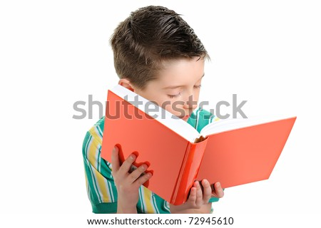 Small boy reading a book on a white background - stock photo