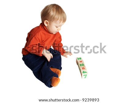 small boy sitting near to cubes - stock photo