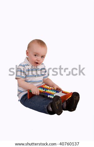 Small boy sitting with abacus - stock photo