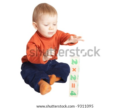 Small boy studies to count. Isolated on white - stock photo