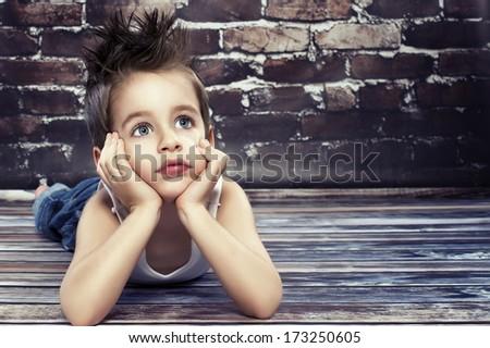 Small boy thinking - stock photo