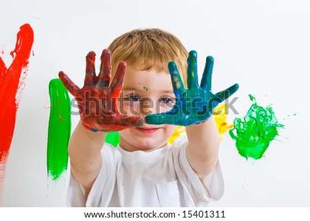 Small boy with a lot of paint on his hands