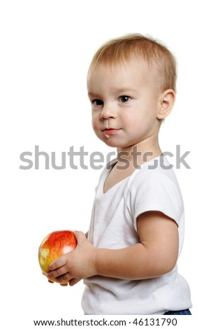 small boy with a red apple on the white background - stock photo