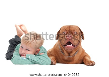 Small boy with dogue de bordeaux lying on the floor - stock photo