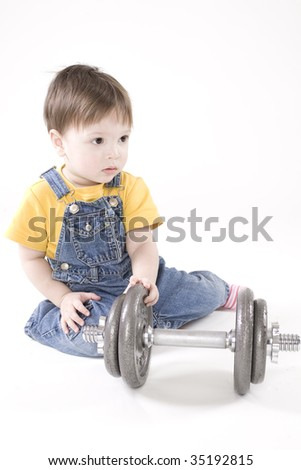 small boy with dumbbell