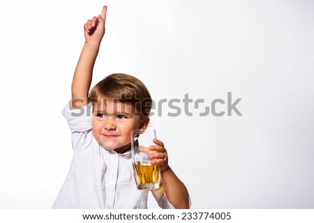 Small boy with orange juice. - stock photo