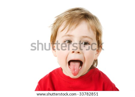 Small boy with  pulling funny face