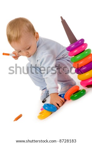 small boy with toys on white background