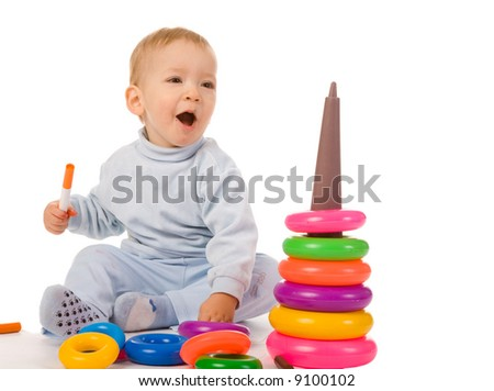 small boy with toys on white background - stock photo