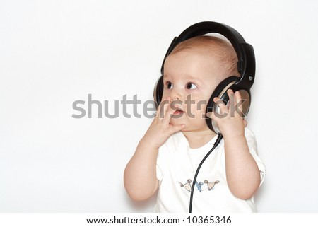small boys with headphones - stock photo