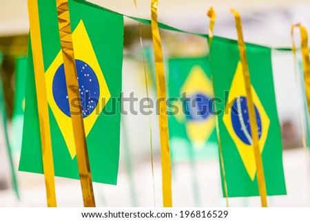 Small Brazil flags commonly used to decorate streets to support soccer cups. - stock photo