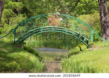 small bridge in a park on a sunny spring day