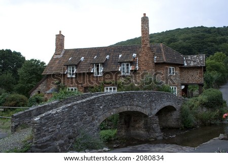 Small Bridge leading to an old English cottage