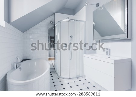 Small bright bathroom in classic modern style - stock photo
