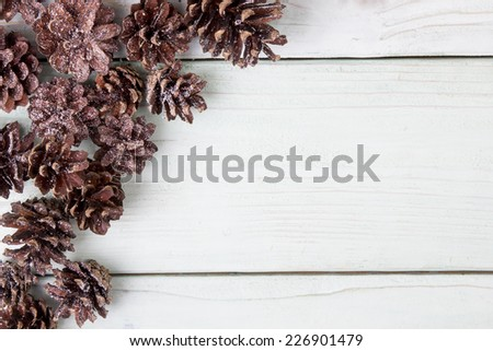 small brown bumps lie on a wooden surface - stock photo