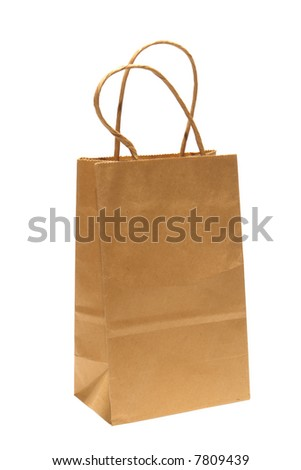 Small brown kraft paper bag with handles to carry store purchases isolated on white