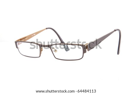Small brown spectacles on a white background. - stock photo