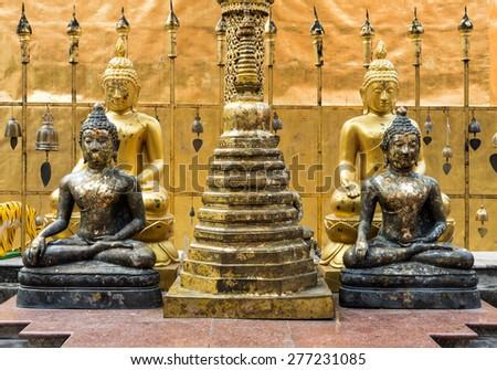 Small Buddha statue near the pagoda model in the Chiang Mai,Thailand. - stock photo