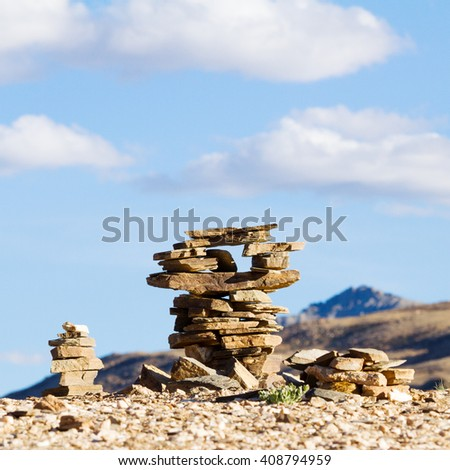 Small Buddhist stupas, collected in the form of a stack of zen stones in the vicinity of the Tso Moriri lake (Himalayas, Ladakh, India) - stock photo