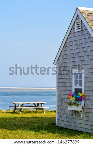 Small Building Overlooking Cape Cod Waters - stock photo