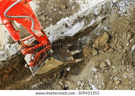 small bulldozer excavator  construction vehicle working for repair water and sewer pipes in street city - stock photo