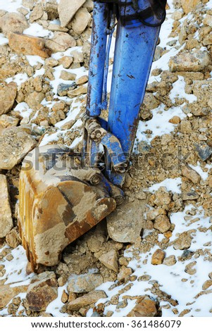 Small bulldozer excavator loader machine works outdoors at construction site.